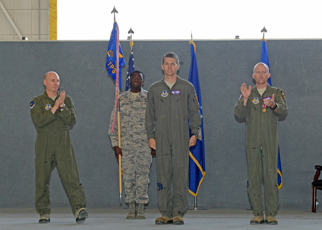 New U.S. Air Force Test Pilot School commandant Col. Ryan Blake (center) is flanked by Brig. Gen. Carl Schaefer, 412th Test Wing commander (left), and outgoing commandant, Col. Matthew Higer (right), during a change of command ceremony in Hangar 1207 July 10. (U.S. Air Force photo by Kenji Thuloweit)