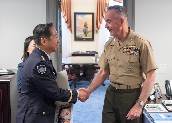 Chairman of the Joint Chiefs of Staff Gen. Joe Dunford greets Chief of Staff, Japan Ground Self-Defense Force, Gen. Koji Yamazaki during an office visit in the Pentagon, July 10, 2018.