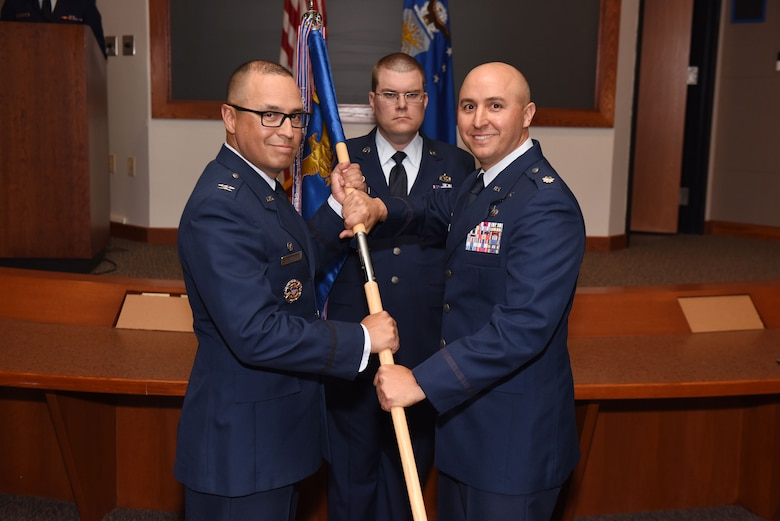 Col. Curtis Hernandez, 30th Operations Group commander, and Lt. Col. Max Coberly, 30th Range Management Squadron commander, inactivate the 30th RMS and merge with the 2nd Range Operations Squadron at Vandenberg Air Force Base, Calif., on July 10, 2018. The reorganization allows all range mission assurance operations to be conducted under a single chain of command. (U.S. Air Force photo by Tech. Sgt. Jim Araos/Released)