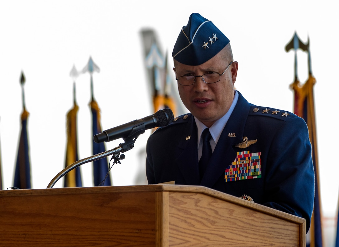 U.S. Air Force Lt. Gen. GI Tuck, 18th Air Force commander, Scott Air Force Base, Ill., presides over the 60th Air Mobility Wing Change of Command