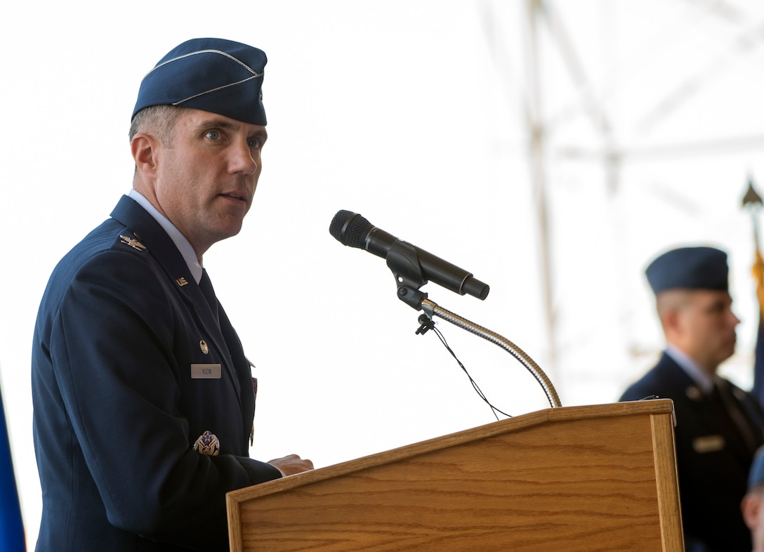 U.S. Air Force Col. John Klein delivers his final speech as commander, 60th Air Mobility Wing, during a change of command ceremony, July 10, 2018, Travis Air Force Base, Calif. Klein relinquished command of Air Mobility Command's largest wing to Col. Ethan Griffin. (U.S. Air Force Photo by Heide Couch)