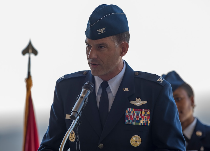 U.S. Air Force Col. Ethan Griffin delivers his first speech as commander, 60th Air Mobility Wing, during a change of command ceremony, July 10, 2018, Travis Air Force Base, Calif.  Klein relinquished command of Air Mobility Command's largest wing to Col. Ethan Griffin. (U.S. Air Force Photo by Heide Couch)