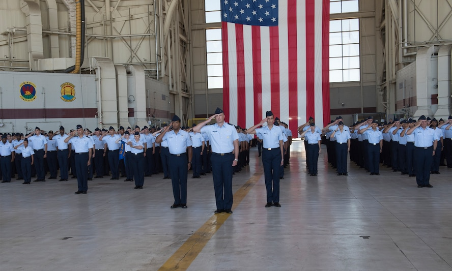 U.S. Air Force Airman render a final salute to Col. John Klein, commander, 60th Air Mobility Wing during a change of command ceremony, July 10, 2018, Travis Air Force Base, Calif.  Klein relinquished command of Air Mobility Command's largest wing to Col. Ethan Griffin. (U.S. Air Force Photo by Heide Couch)
