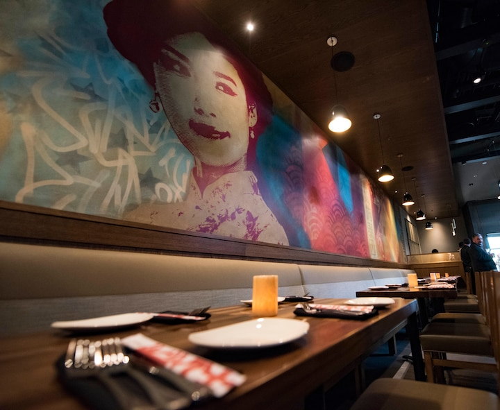 P.F. Chang's became the newest restaurant on Ramstein Air Base, Germany, when a red-ribbon cutting on June 25, 2018, unveiled this project that has been four years in the making. The interior of the restaurant is fully furnished, including a one of a kind mural, created by two artists from the United Kingdom. The mural features imagery and phrases in Mandarin meant to honor U.S. servicemembers.