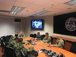 A team of Soldiers from the Colombian army met with South Carolina Army National Guard leadership and experts from the South Carolina Emergency Management Division to discuss disaster response best practices and lessons learned at the South Carolina National Guard Joint Operations Center, June 29, 2018.
