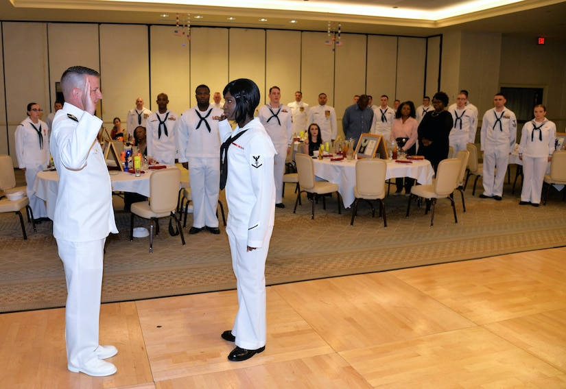 Navy Petty Officer 3rd Class Lasonya Lowe, center, a hospital corpsman serving at Naval Health Clinic Charleston, swears the Oath of Enlistment as she reenlists June 16, 2018, during NHCC's Corpsman Ball at the Charleston Club. Lt. Terry Starkey, left, head of NHCC's Occupational Medicine, served as Lowe's reenlisting officer.