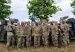 Soldiers of the 209th Digital Liaison Detachment, 7th Mission Support Command welcomed their new commander, Col.  Stephen P. Case by asking him to pose for a unit photo, following their change of command ceremony held at McCully Barracks on July 7, 2018.