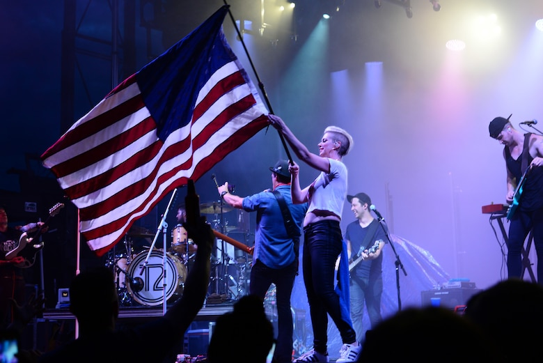 Shawna Thompson, lead singer for the American country music group Thompson Square, waves an American Flag during their performance July 6, 2018, on Columbus Air Force Base, Mississippi. Patriot Fest 2018 featured a concert with Thompson Square and Easton Corbin along with food vendors and children's activities. (U.S. Air Force photo by Airman 1st Class Beaux Hebert)