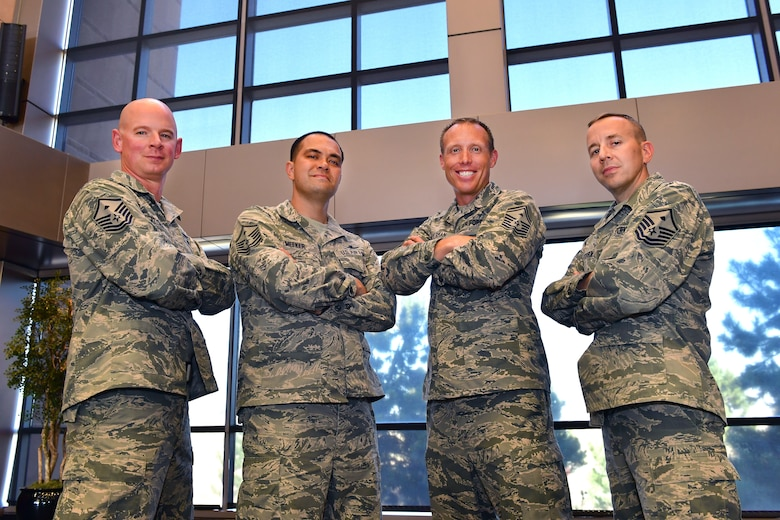 SCHRIEVER AIR FORCE BASE, Colo. -- First Sergeants from the 50th Space Wing pose for a group photo in the wing headquarters building 9 June, 2018 at Schriever Air Force Base.  Left to right are MSgt Ryan Klemcke, 50th Security Forces Squadron; MSgt Travis Meeker, 50th Mission Support Group; SMSgt Justin Halterman, 50th Operations Group; and MSgt Chad Peterson, 50th Network Operations Group.