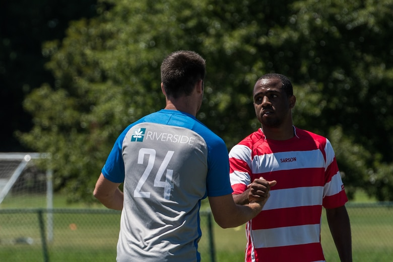 Lee Williams, Lionsbridge Football Club defender, and U.S. Air Force Airman 1st Class Jairzinho Burke, Joint Base Langley-Eustis Soccer Club midfielder, commend each other on a good game after a scrimmage at Riverview Park, Newport News, Virginia, July 8, 2018.