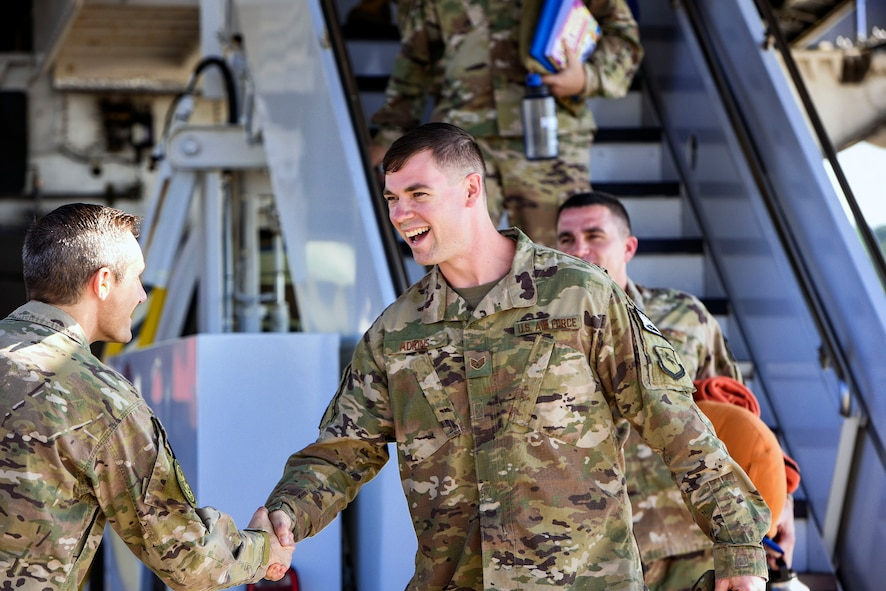 Staff Sgt. Scott Adkins, right, 723d Aircraft Maintenance Squadron aircraft armament specialist, is welcomed home by Col. Justin Demarco, 23d Wing vice commander, during the 41st Rescue Squadron's redeployment ceremony, July 10, 2018, at Moody Air Force Base, Ga. While deployed, the 41st RQS and 41st Helicopter Maintenance Unit provided combat search and rescue capabilities and maintenance operations in support of Combined Joint Task Force-Horn of Africa. (U.S Air Force photo by Senior Airman Greg Nash)