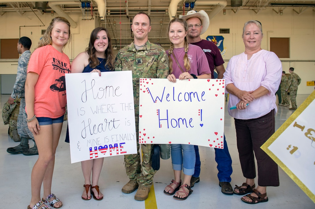 cCapt. Dalton Bridgers, 41st Rescue Squadron (RQS) HH-60G Pave Hawk pilot, reunites with his family during a redeployment ceremony, July 10, 2018, at Moody Air Force Base, Ga. While deployed, the 41st RQS and 41st Helicopter Maintenance Unit provided combat search and rescue capabilities and maintenance operations in support of Combined Joint Task Force-Horn of Africa. (U.S Air Force photo by Senior Airman Greg Nash)