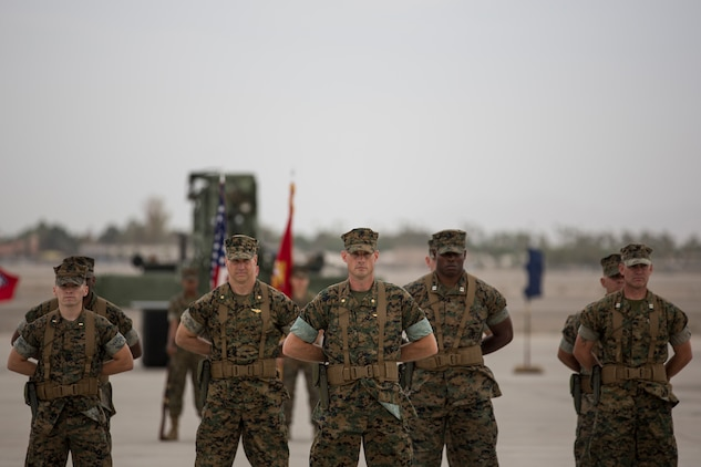 U.S. Marines with Headquarters and Headquarters Squadron (H&HS), Marine Corps Air Station (MCAS) Yuma, participate in the Change of Command Ceremony where Lt. Col. James S. Tanis, commanding officer for H&HS relinquished command to Lt. Col. James C. Paxton on MCAS Yuma, Ariz., June 15, 2018. The Change of Command Ceremony represents the transfer of responsibility, authority, and accountability from the outgoing commanding officer to the incoming commanding officer. (U.S. Marine Corps photo by Sgt. Allison Lotz)