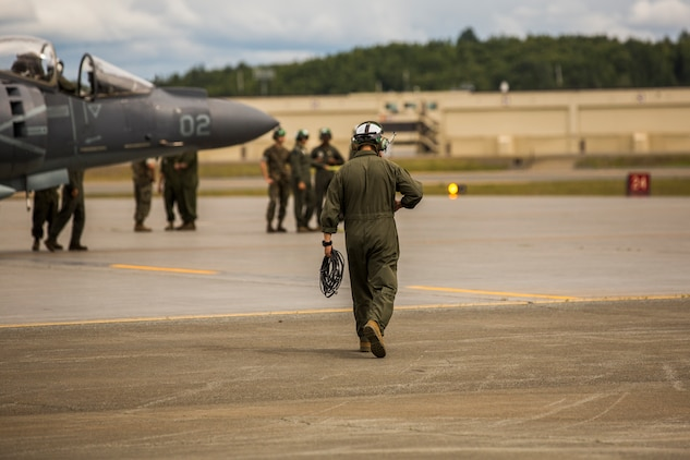 Marine Attack Squadron (VMA) 214 Marines participate in the 2018 Arctic Thunder Air Show at Joint Base Elmendorf-Richardson, Alaska, June 29, 2018. VMA-214 conducted a flyby and hover demonstration with the AV-8B Harrier during the air show. (U.S. Marine Corps photo by Lance Cpl. Sabrina Candiaflores)