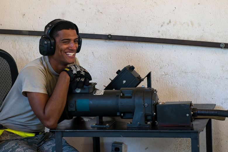 Senior Airman Skyler Hall, 23d Maintenance Squadron (MXS) crew chief, smiles during a 30mm rounds processing, July 11, 2018, at Moody Air Force Base, Ga. This total force integration training with the 23d and 476th MXS allowed Airmen to work together to identify more ways to efficiently and safely conduct their mission. The munitions flight ensures the A-10C Thunderbolt IIs are armed with 30mm rounds to make sure they are able to continue their mission while at home station and deployed. (U.S. Air Force photo by Airman 1st Class Erick Requadt)