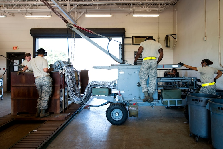 Airmen from the 476th and 23d Maintenance Squadron (MXS) work together during a 30mm rounds processing, July 11, 2018, at Moody Air Force Base, Ga. This total force integration training with the 23d and 476th MXS allowed Airmen to work together to identify more ways to efficiently and safely conduct their mission. The munitions flight ensures the A-10C Thunderbolt IIs are armed with 30mm rounds to make sure they are able to continue their mission while at home station and deployed. (U.S. Air Force photo by Airman 1st Class Erick Requadt)