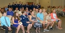 Keesler personnel, families and friends attend the 81st Communications Squadron change of command ceremony in the Roberts Consolidated Aircraft Maintenance Facility Auditorium at Keesler Air Force Base, Mississippi, June 28, 2018. U.S. Air Force Maj. Jon Drummond, incoming 81st CS commander, assumes command from Lt. Col. Jerry Hambright, outgoing 81st CS commander, with the passing of the guidon. (U.S. Air Force photo by Andre' Askew)