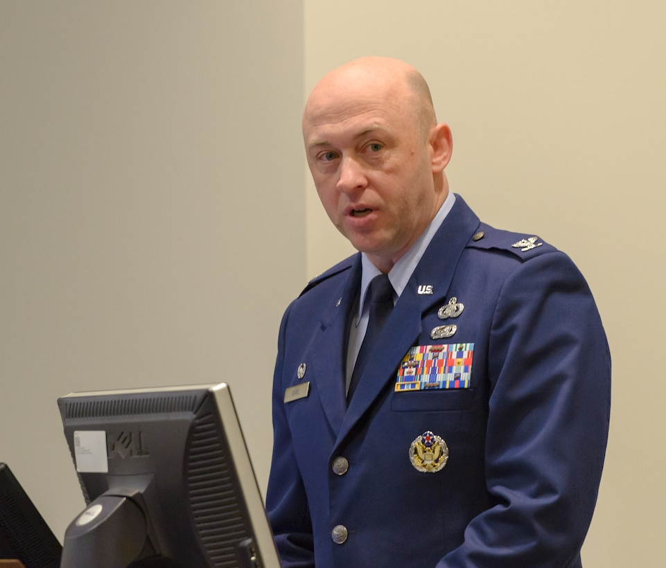 U.S. Air Force Col. Danny Davis, 81st Mission Support Group commander, delivers remarks during the 81st Communications Squadron change of command ceremony in the Roberts Consolidated Aircraft Maintenance Facility Auditorium at Keesler Air Force Base, Mississippi, June 28, 2018. During the ceremony, Davis highlighted the accomplishments of the squadron under the command of Lt. Col. Jerry Hambright and introduced the incoming commander, Maj. Jon Drummond. (U.S. Air Force photo by Andre' Askew)