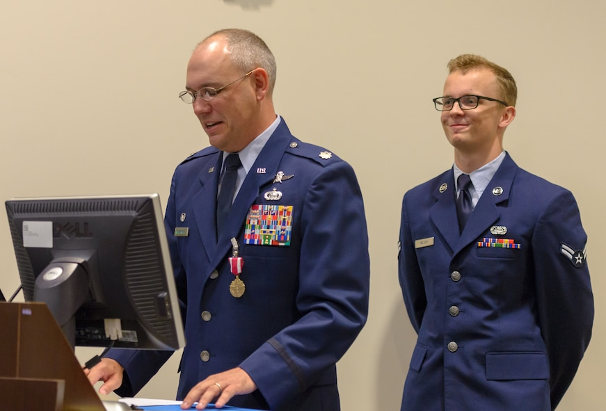 U.S. Air Force Lt. Col. Jerry Hambright, outgoing 81st Communications Squadron commander, delivers remarks during the 81st CS change of command ceremony in the Roberts Consolidated Aircraft Maintenance Facility Auditorium at Keesler Air Force Base, Mississippi, June 28, 2018. Maj. Jon Drummond assumed command of the 81st CS. (U.S. Air Force photo by Andre' Askew)