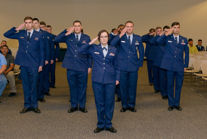 U.S. Air Force Capt. Rachel Donoho, 81st Communications Squadron flight commander, renders a salute with 81st CS personnel in formation during the 81st Communications Squadron change of command ceremony in the Roberts Consolidated Aircraft Maintenance Facility Auditorium at Keesler Air Force Base, Mississippi, June 28, 2018. 81st CS personnel gave a farewell salute to the outgoing 81st CS commander, Lt. Col. Jerry Hambright, and a welcoming salute to the new commander, Maj. Jon Drummond. (U.S. Air Force photo by Andre' Askew)