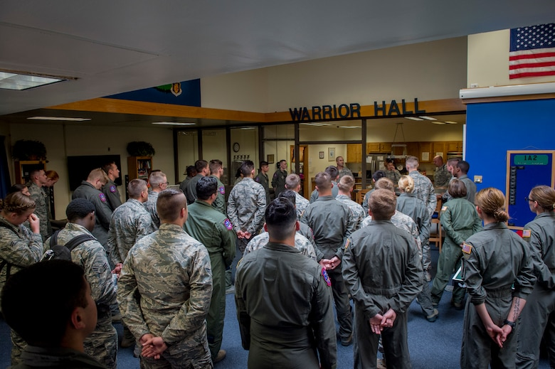 Boom operators and loadmasters of the 97th Training Squadron attend their weekly role call for any need to know information, July 3, 2018 at Altus Air Force Base, Okla.