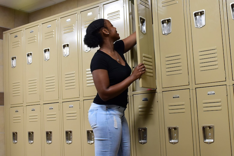 U.S. Air Force Airman 1st Class Chelsi Knott, 633rd Force Support Squadron services journeyman uses a new locker in the Crossbow Dining Facility at Joint Base Langley-Eustis, Virginia, July 10, 2018. The renovations provide a better work environment for facility employees. (U.S. Air Force photo by Airman 1st Class Monica Roybal)