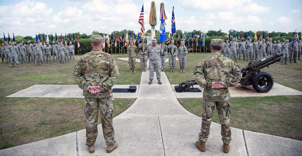Col. David L. Raugh (left) and Col. Samuel E. Fiol (right) stand at parade rest during the 502nd Force Support Group change of command ceremony held at the JBSA-Fort Sam Houston base flagpole July 11. Raugh turned over command of the group to Fiol during the ceremony.