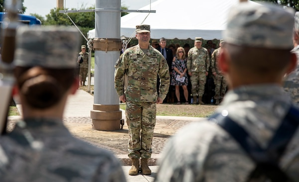 Col. Samuel E. Fiol stands at attention after receiving command of the 502nd Force Support Group in a change of command ceremony held at the JBSA-Fort Sam Houston base flagpole July 11, where he took over for outgoing commander Col. David L. Raugh.