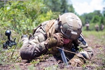 U.S. Air Force Tech. Sgt. Michael Sweeney, NCOIC of explosive ordnance disposal operations assigned to the 6th Civil Engineer Squadron, probes for a simulated improvised explosive device at MacDill Air Force Base, Fla., July 2, 2018.