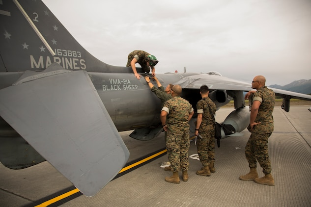 U.S. Marines assigned to Marine Attack Squadron (VMA) 214 conduct their daily inspections after the arrival of their AV-8B Harriers at Joint Base Elmendorf-Richardson, Alaska, June 27, 2018. VMA-214 will participate in the 2018 Arctic Thunder Air Show with a flyby, hover demonstration, and a static display. (U.S. Marine Corps photo by Lance Cpl. Sabrina Candiaflores)