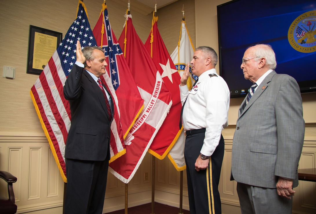 Mississippi River Commission President Maj. Gen. Richard Kaiser administers the oath of office to James A. Reeder at the MRC headquarters in Vicksburg, Miss., July 11, 2018.