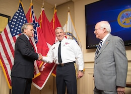 Mississippi River Commission President Maj. Gen. Richard Kaiser and Sam Angel, the MRC's longest standing member, congratulate James A. Reeder after his swearing in at the MRC headquarters in Vicksburg, Miss., July 11, 2018.