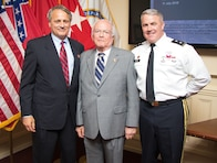 Mississippi River Commission President Maj. Gen. Richard Kaiser and MRC members James A. Reeder and Sam Angel stand in the MRC headquarters in Vicksburg, Miss., July 11, 2018.
