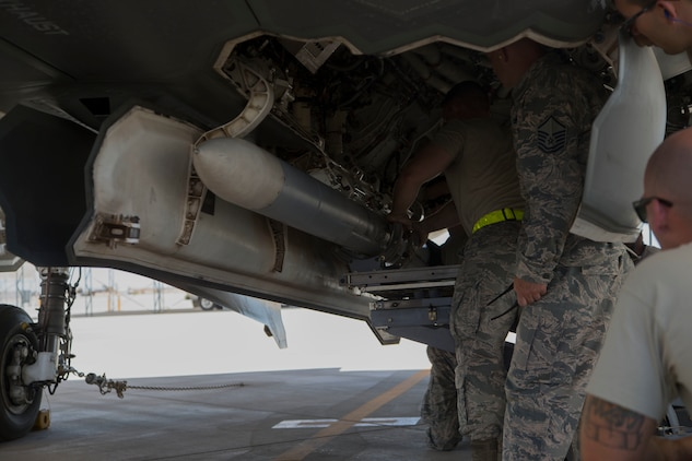 U.S. Airmen attached to the 4th Aircraft Maintenance Unit, Hill Air Force Base, Utah, load ordnance on to an F-35B Lightning II on MCAS Yuma Ariz., June 26, 2018. The exercise tested, for the first time, the interoperability of loading weapon systems between the services F-35's. The U.S. Air Force Operates with the F-35A Lightning II, while the U.S. Marine Corps Operates with the F-35B Lightning II. (U.S. Marine Corps photo by Lance Cpl. Joel Soriano)