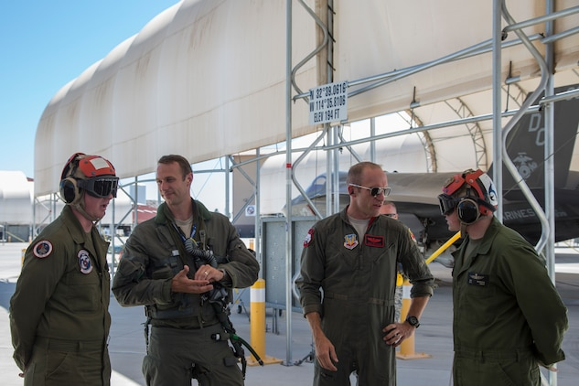 "U.S. Airmen Maj. Caleb ""Skeet"" Guthman, and Capt. Timothy ""Check"" Six, pilots, attached to Hill Air Force Base, Utah, discuss upcoming exercises with U.S. Marines on MCAS Yuma, Ariz., June 26, 2018. The exercise tested, for the first time, the interoperability of loading weapon systems between the services F-35's. The U.S. Air Force operates with the F-35A Lightning II, while the U.S. Marine Corps operates with the F-35B Lightning II. (U.S. Marine Corps photo by Sgt. Allison Lotz)"