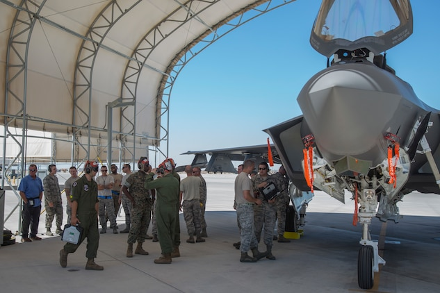 U.S. Marines with Marine Fighter Attack Squadron (VMFA) 122, Marine Corps Air Station (MCAS) Yuma, conduct exercises with U.S. Airmen attached to the 4th Aircraft Maintenance Unit, Hill Air Force Base, Utah, on MCAS Yuma, Ariz., June 26, 2018. The exercise tested, for the first time, the interoperability of loading weapon systems between the services F-35's. The U.S. Air Force operates with the F-35A Lightning II, while the U.S. Marine Corps operates with the F-35B Lightning II. (U.S. Marine Corps photo by Sgt. Allison Lotz)
