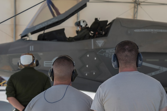 U.S. Airmen attached to the 4th Aircraft Maintenance Unit, Hill Air Force Base, Utah, watch as U.S. Marines with Marine Fighter Attack Squadron (VMFA) 122, Marine Corps Air Station (MCAS) Yuma, launch an F-35B Lightning II on MCAS Yuma, Ariz., June 26, 2018. The airmen watched as part of an exercise which tested, for the first time, the interoperability of loading weapon systems between the services F-35's. The U.S. Air Force operates with the F-35A Lightning II, while the U.S. Marine Corps operates with the F-35B Lightning II. (U.S. Marine Corps photo by Sgt. Allison Lotz)