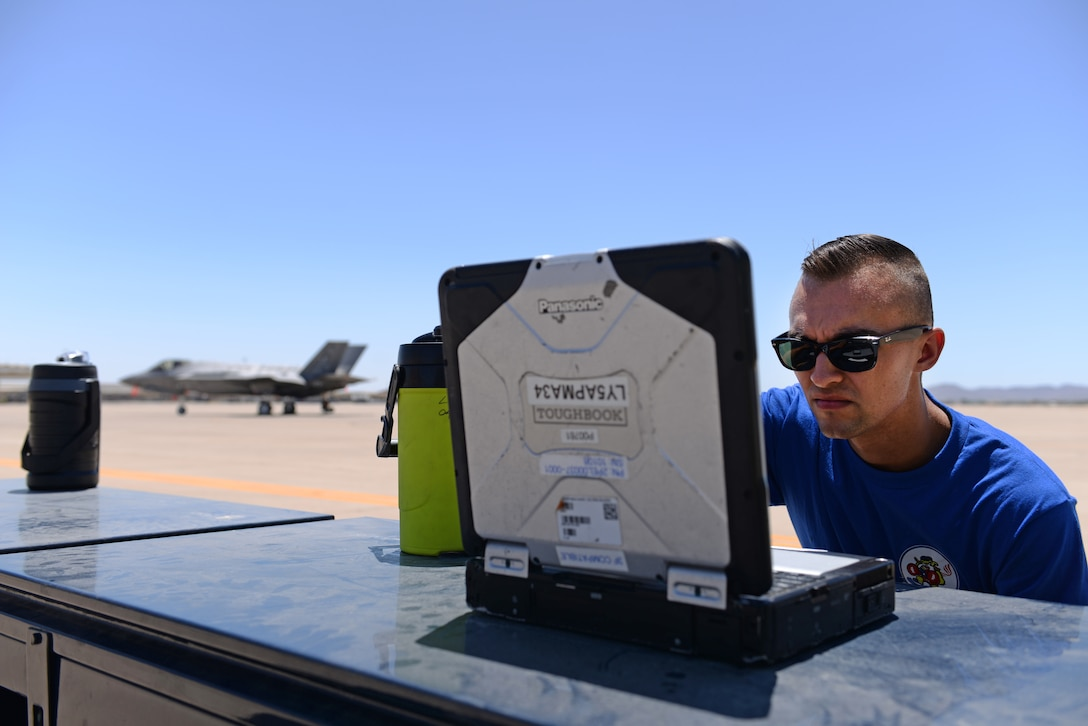 A 62nd Aircraft Maintenance Unit Lightning Integrated Technician team member evaluates maintenance tasks on a maintenance laptop June 8, 2018, at Luke Air Force Base, Ariz. The LIT team is a new joint team of combined maintenance professionals from separate specialties in the maintenance career field. (U.S. Air Force photo by Senior Airman Ridge Shan)