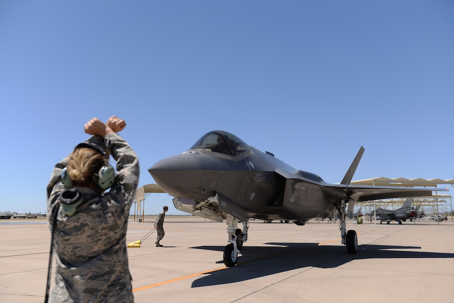Lightning Integrated Technician team members taxi-in an F-35A Lightning II June 8, 2018, at Luke Air Force Base, Ariz. With the LIT team, multiple components of an aircraft undergoing maintenance can be worked on simultaneously. (U.S. Air Force photo by Senior Airman Ridge Shan)