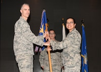 Col. Casey Campbell, 51st Medical Group commander, gives the 51st Medical Group guidon to Lt. Col. Jennifer Lavergne during a change of command ceremony at the Enlisted Club, June 29, 2018. During the ceremony, Lt. Col. Jennifer Lavergne took command of the 51st Medical Support squadron from Lt. Col. Charles Marek, 51st MDSS outgoing commander. (U.S. Air Force photo by Airman 1st Class Ilyana A. Escalona)