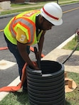 Sean Dawley Jr., a senior architecture major from Hampton University, conducts a water retention inspection at Camp Humphreys, South Korea, July 5