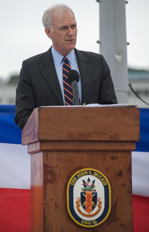 Secretary of the Navy Richard V. Spencer speaks during a ceremony aboard the guided-missile destroyer USS John S. McCain (DDG 56) to induct U.S. Sen. John S. McCain III into the ship's official namesake July 12, 2018. Expanding the namesake to include Senator McCain honors his family's three generations of dedicated service to the U.S. Navy.