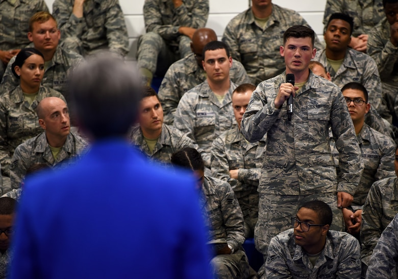 Secretary of the Air Force Heather Wilson takes a question from a Liberty Wing Airman at Royal Air Force Lakenheath, England, July 11, 2018. During the town hall, Wilson explained how the Air Force is focusing on the fight of the future and the importance of the branch's current five major priorities: restoring readiness, completing cost-effective modernization, driving innovation, developing exceptional leaders, and strengthening U.S. Alliances and partnerships. (U.S. Air Force photo by Staff Sgt. Alex Fox Echols III)