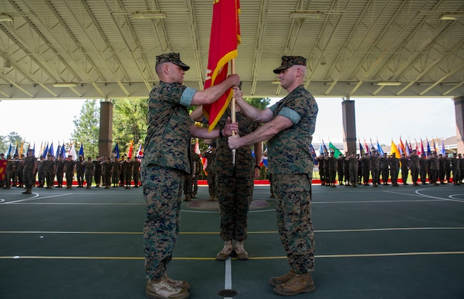 Lt. Col. Lawrence C. Coleman, off-going commanding officer, transfers command to Lt. Col. Scott O. Meredith, on-coming commanding officer, Wounded Warrior Battalion-East, at the WWBN-East Outdoor Basketball Pavilion on Marine Corps Base Camp Lejeune, N.C., June 21, 2018. The change of command formally transferred authorities and responsibilities of WWBN-E from Lt. Col. Lawrence C. Coleman to Lt. Col. Scott O. Meredith. (U.S. Marine Corps photo by Lance Cpl. Nathan Reyes)