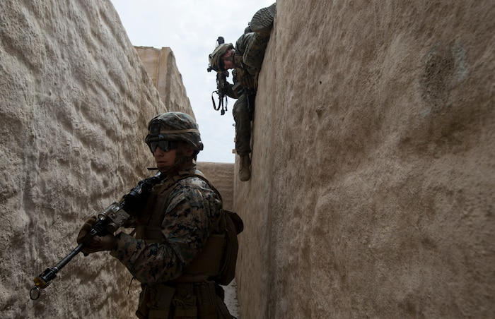"""U.S. Marine Corps Lance Cpl. Austin Mellick, a fireteam leader with 2nd Battalion, 1st Marine Regiment, provides security at an Infantry Immersion Trainer during Rim of the Pacific exercise on Marine Corps Base Camp Pendleton, California, July 10, 2018. The IIT provided the Marines with """"hands on"""" practical application of tactical skills and decision making in an immersive, scenario-based training environment. RIMPAC demonstrates the value of amphibious forces and provides high-value training for task-organized, highly capable Marine Air-Ground Task Forces enhancing the critical crisis response capability of U.S. forces and partners globally. Twenty-five nations, 46 ships, five submarines, about 200 aircraft and 25,000 personnel are participating in RIMPAC from June 27 to Aug. 2 in and around the Hawaiian Islands and Southern California."""