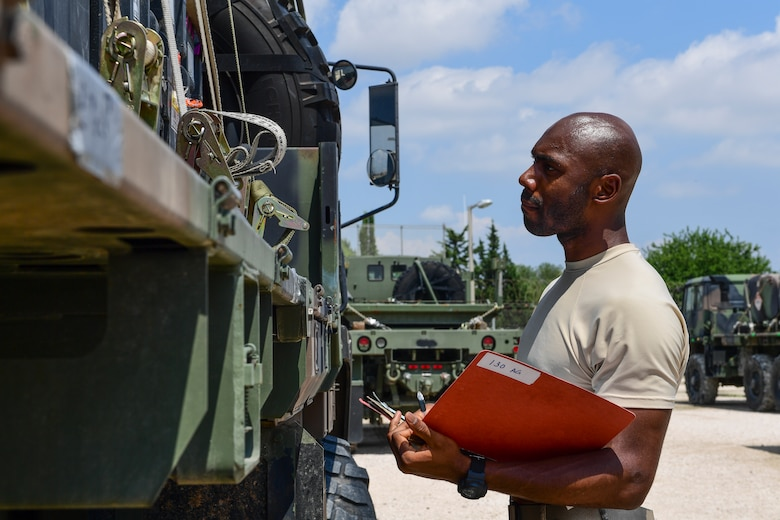 An Airman inspects a piece of equipment.