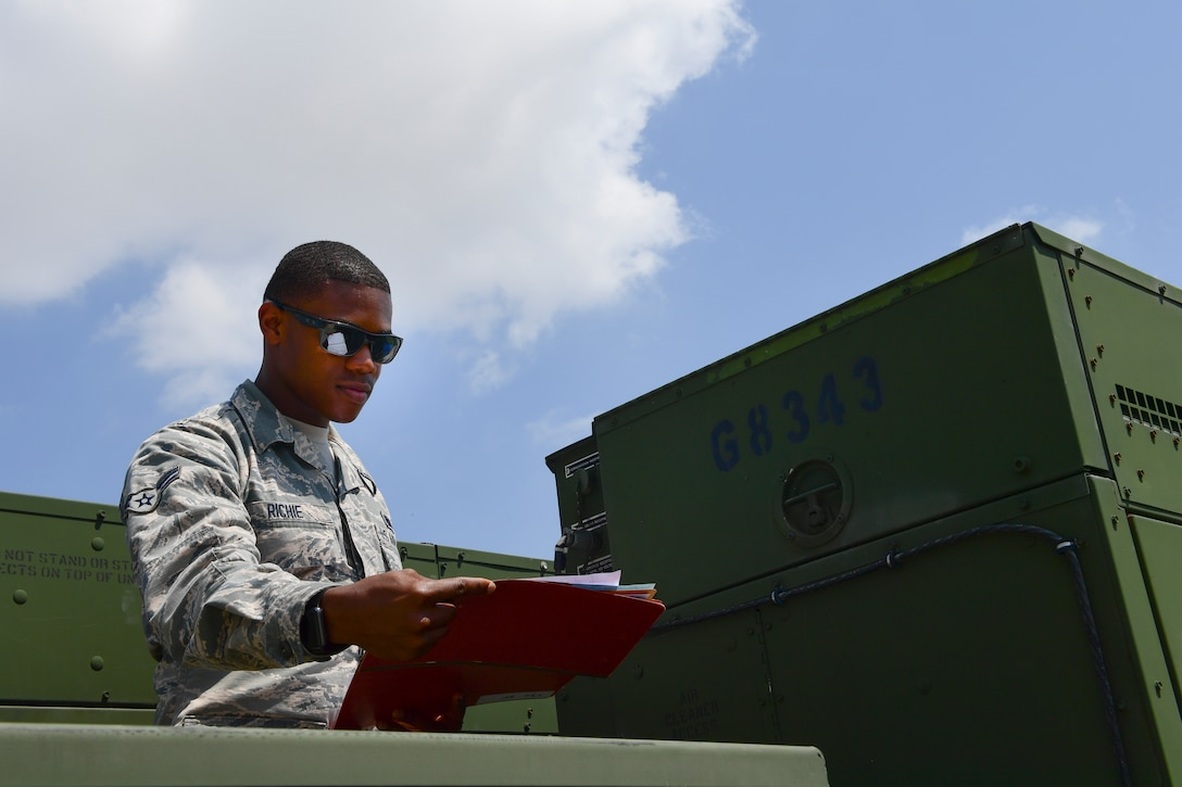 Airman inspecting a piece of equipment.