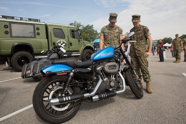 Marines admire a motorcycle during the exposition portion of a Semper Ride event on Marine Corps Base Camp Lejeune, June 26. Educating service members on the correct way to ride a motorcycle is the main mission of Semper Ride gatherings. (U.S. Marine Corps photo by Lance Cpl. Nathan Reyes)
