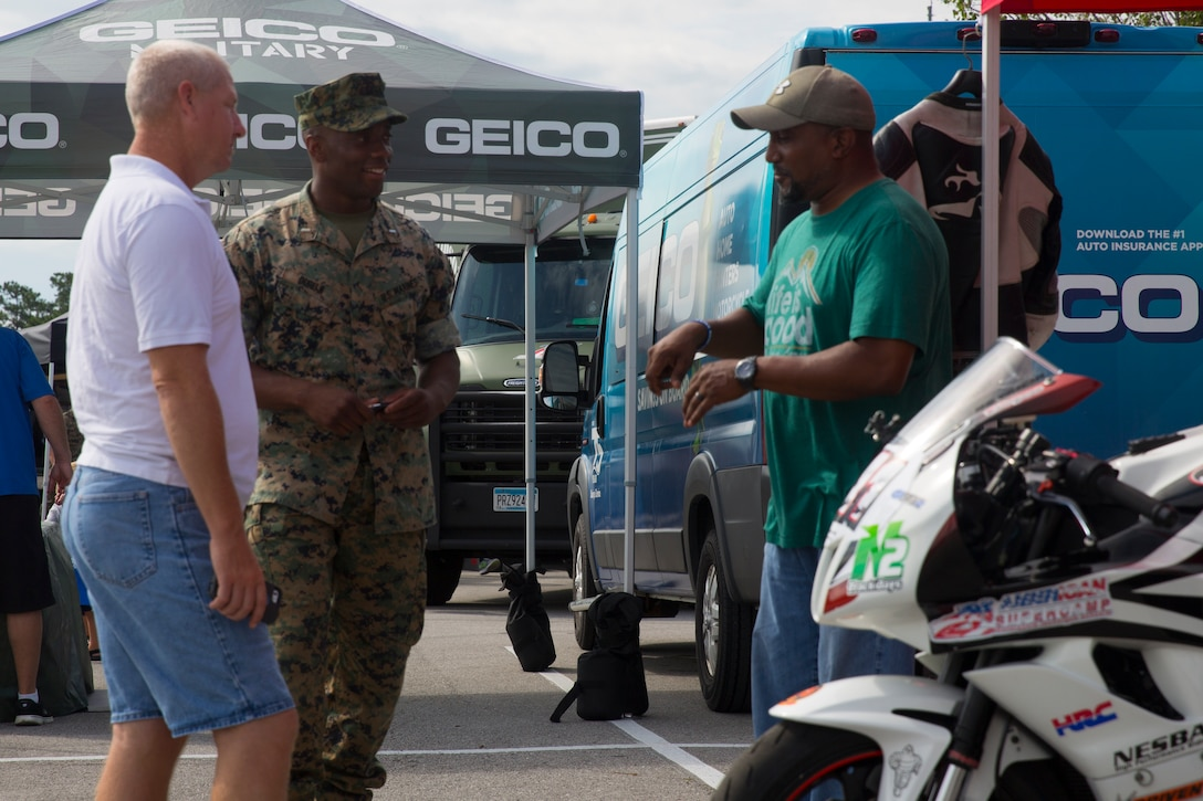 Marines discuss motorcycle safety during the exposition portion of a Semper Ride event on Marine Corps Base Camp Lejeune, June 26. Educating service members on the correct way to ride a motorcycle is the main mission of Semper Ride gatherings. (U.S. Marine Corps photo by Lance Cpl. Nathan Reyes)