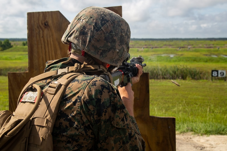 A Marine with Fox Company, Marine Combat Training Battalion (MCT), School of Infantry-East, fires a M16A4 Service Rifle during Table 3 and 4 marksmanship training, Camp Lejeune, N.C., June 27, 2018. MCT conducts standards-based common combat skills training of entry-level Marines in order to create riflemen for service throughout the Marine Corps. (U.S. Marine Corps photo by Lance Cpl. Ashley Gomez)